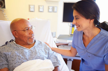 A guy patient and a lady caregiver talking to each other