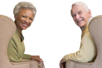 Two elder people smiling at the camera